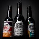 Wicked Barrel Brewery. Un progetto di Direzione artistica, Br, ing e identità di marca, Packaging, Tipografia, Progettazione di icone , e Design di loghi di Stefan Andries - 20.08.2018