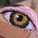 Can can y un ojo. A Embroider project by Elo - Saturno Rosa - 05.31.2021