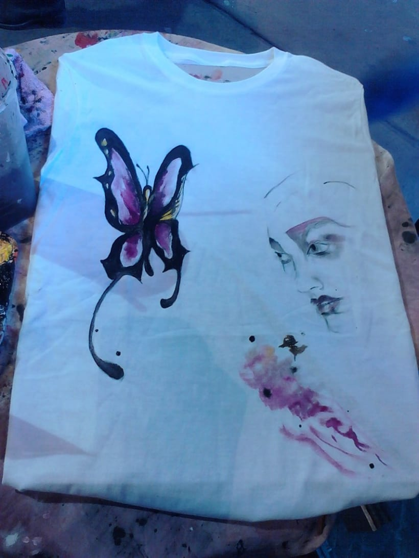 Hand made paintings. T-Shirts and also recycle glass in Camden Market, London 1