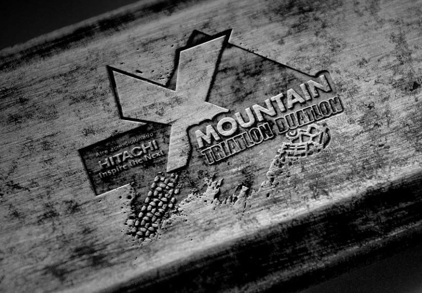 Logo Hitachi X-MOUNTAIN DUATLON-TRIATLON 3
