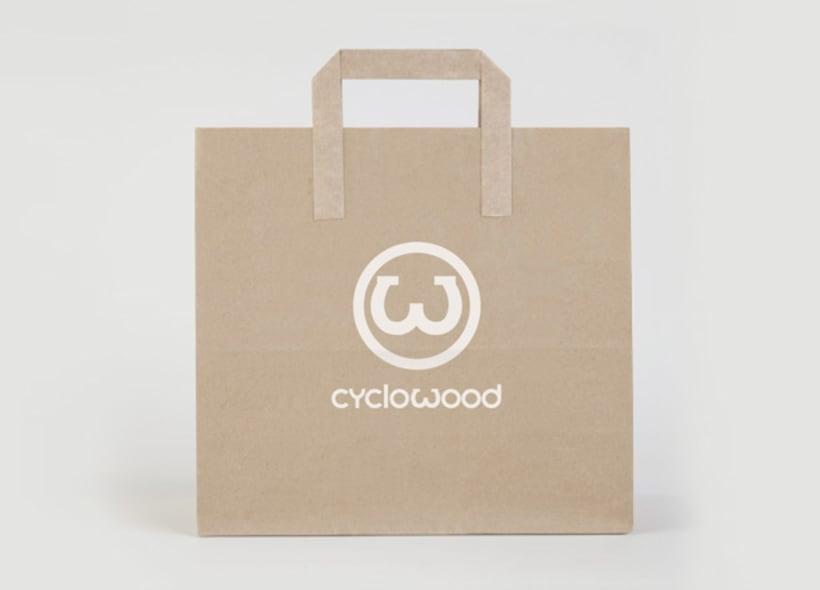 """Cyclowood es el nombre de una empresa gallega de bicicletas exclusivas cuya estructura está hecha en madera.  El icono se basa e una """"W"""" que simula el manillar de una bici. -1"""