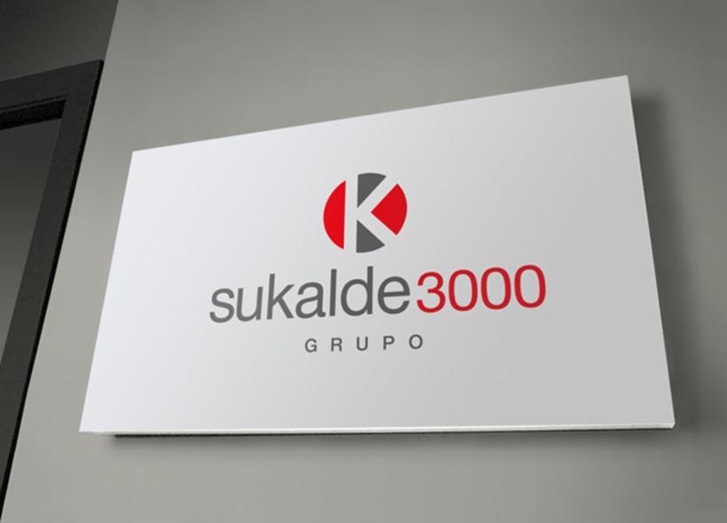 Logotipo para Grupo Sukalde 3000, una empresa vasca especializada en mobiliario de cocina y baño. Además cuenta con una sección de ventas de electrodomésticos, reformas integrales y limpieza de persianas a domicilio. -1