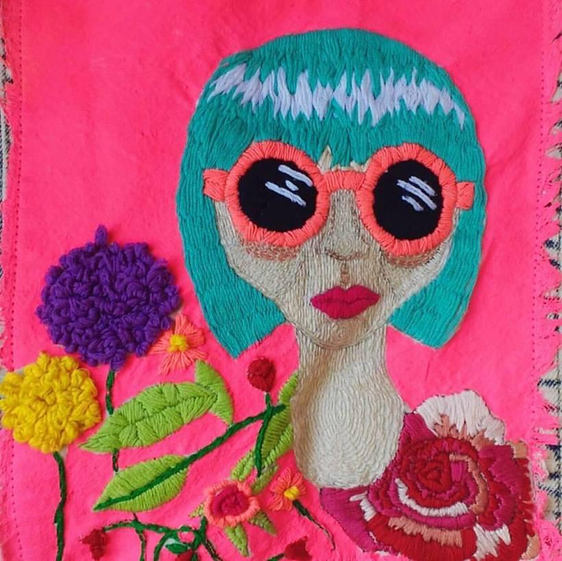 Ilustración bordada sobre la mujer en el mundo 1