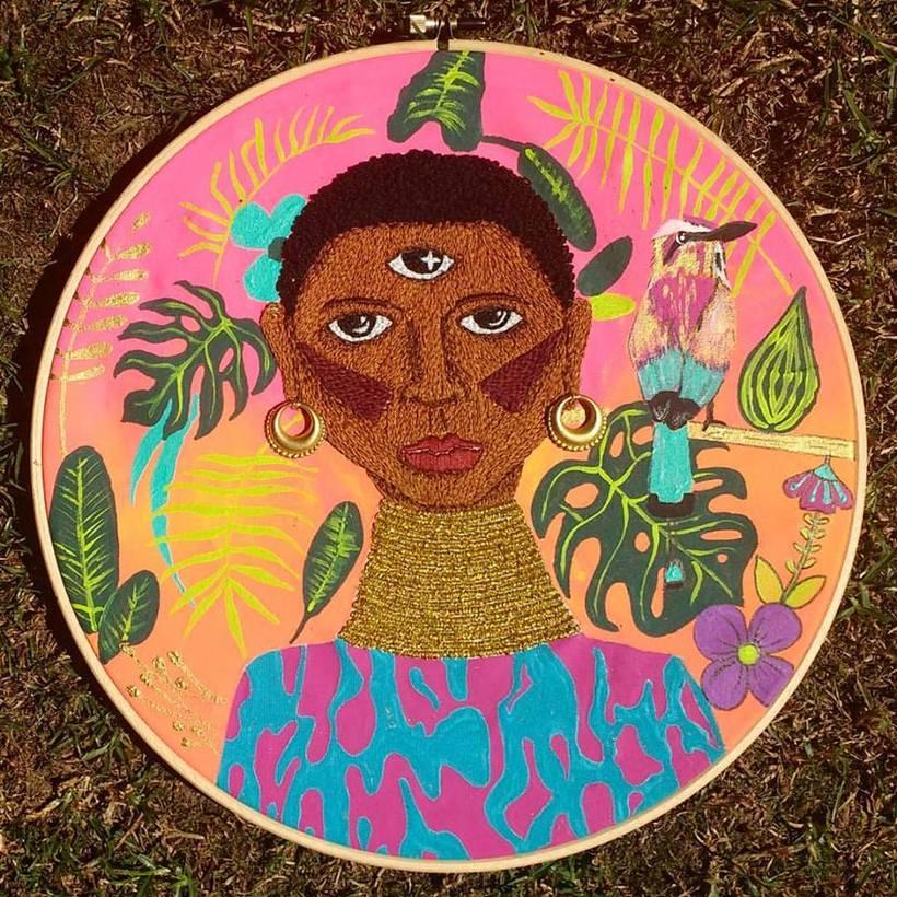 Ilustración bordada sobre la mujer en el mundo 0